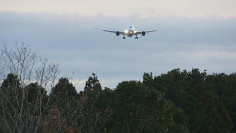 A modern jet approaching the airport over the forest Footage