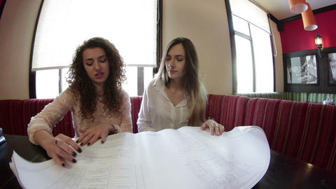 Girls sitting at the diploma work Footage