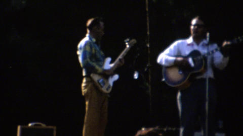 1961: Local music festival band playing on stage people dancing Footage