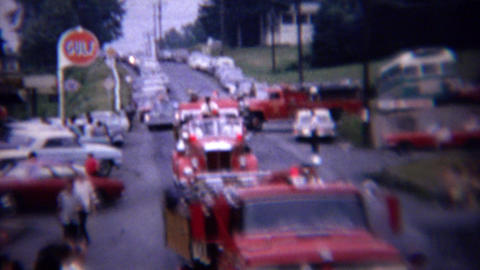 1961: Rural country parade old red fire engine trucks Footage