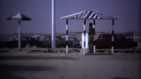 1974: Traffic checkpoint police guards roof shade structure Footage