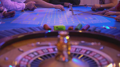 Roulette table in a casino - gamblers putting bets Footage