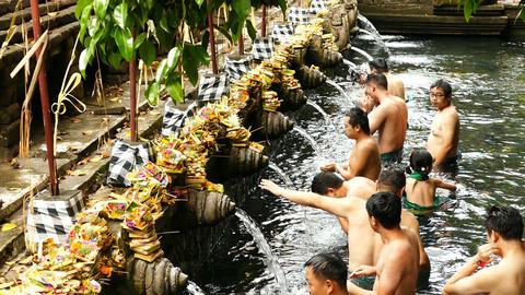 Ritual of water purification at Tirta Empul Temple, Bali Live Action