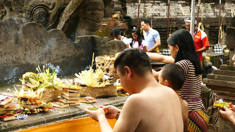 Balinese sacrifice and incense at Tirta Empul Temple, Bali Footage
