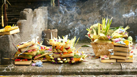 Offering bowls and incense at Tirta Empul Temple, Bali Footage
