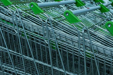 Row of shopping carts at supermarket entrance フォト