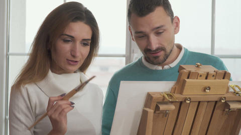 Young man and woman draws a picture Footage