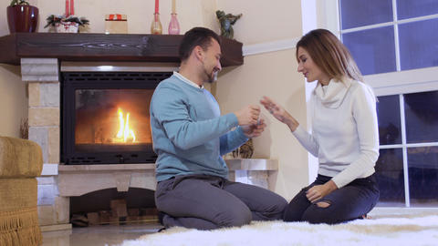 Happy family celebrates a wife pregnancy near fireplace Footage