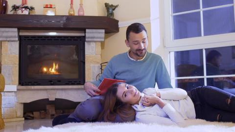Happy married couple near fireplace Footage