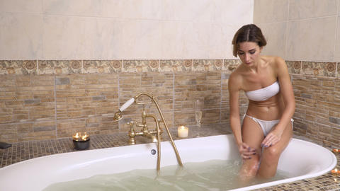 Young woman washing in a bath Footage