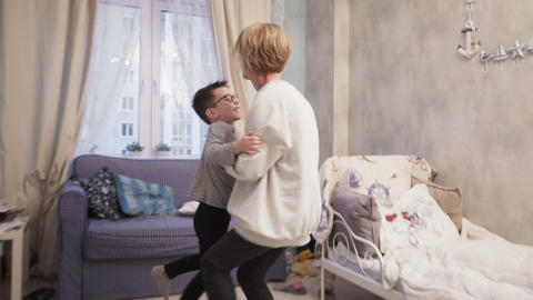 Happy mother hugs her son and dances with him Footage