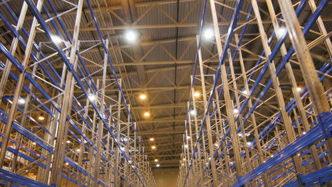 Camera Moves from Ceiling to Floor along Specious Warehouse Footage