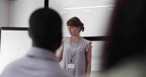 Young female executive speaking at a conference Footage