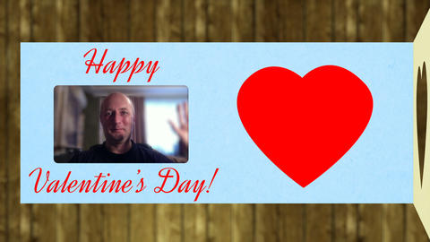 Adult caucasian man congratulates with Valentines Day. Greeting card opens and Filmmaterial