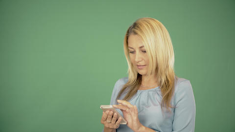 Gorgeous beautiful young woman with blonde hair browses on the smart-phone at Bild