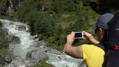 The girl takes a photo of the nature by phone Footage