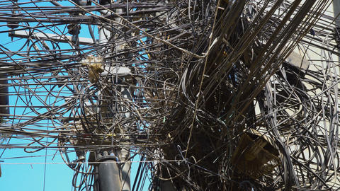 A lot of tangled electrical wires on the pole Footage