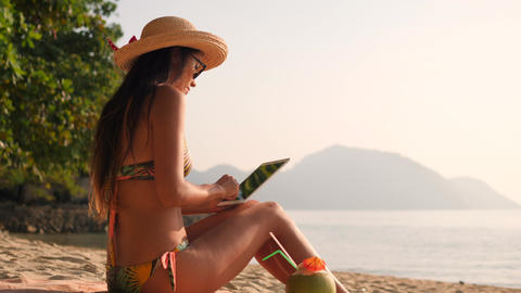 Young Mixed Race Tourist Girl Using Mobile Tablet Gadget and Sunbathing on Live Action