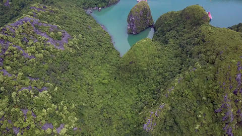 Drone Flies above Fjords with Boats among Green Hilly Islands Footage