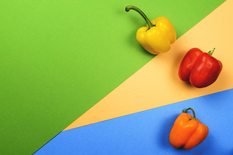Colorful bell peppers on a colorful background. Flat lay. The view from the top Photo