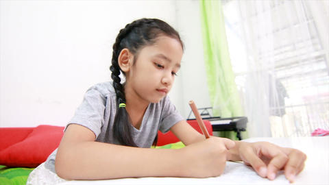 4K Asian little girl doing home work on the table 002 Footage