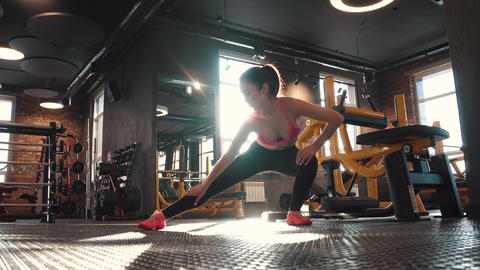 fitness girl doing warm-up in the gym. stretching and preparation for training Footage