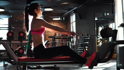fitness girl training in the gym. attractive sportswoman doing an exercise on a Footage