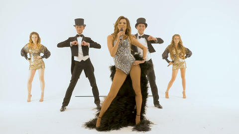 A five professional actors dancing on a white background. the man is wearing a Footage