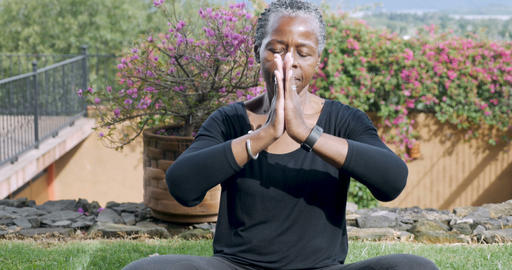 Attractive lively retired African American woman in her 60s puts her hands Footage