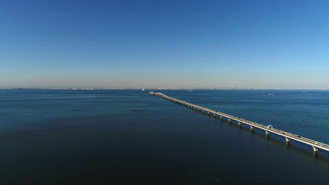 Aerial - Video by rising Tokyo Bay and Bridge in the fine afternoon Live Action