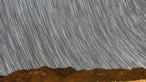 Traces from stars in the form of lines. Milky Way over the mountains Footage