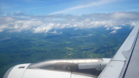 A view from the airplane windowafter take off over the wings and engines. The Footage