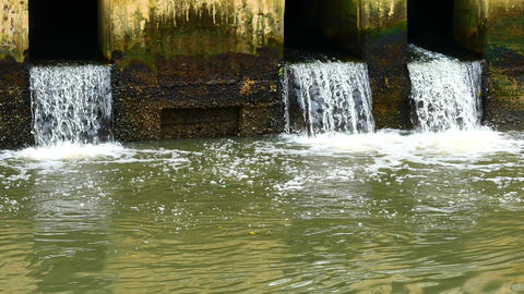 Daily life video After the rain. Water from a canal in the city is dropping down Footage
