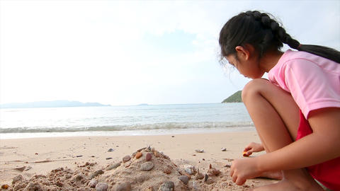 4K Asian little girl playing on the beach 004 Footage