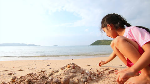 4K Asian little girl playing on the beach 005 Footage