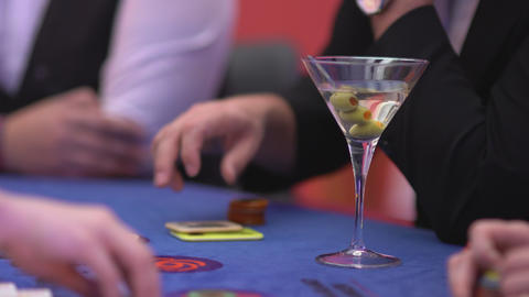 Gambling Black Jack in a casino - nervous gambler playing with tokens Live Action