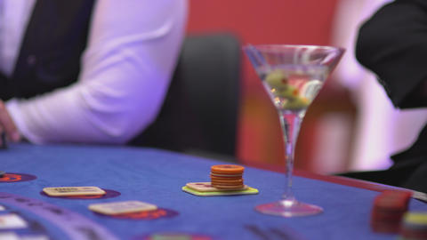 Gambling Black Jack in a casino - nervous gambler waiting for cards Footage