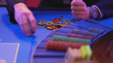 Roulette table in a casino - groupier counts gaming chips Footage