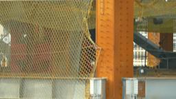 Workers arc welding on building construction site, tilt move Footage