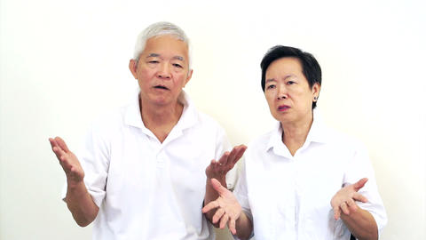 Video of Asian senior couple do not like a deal. Upset and do not satisfy Footage