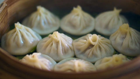 steam Soup Dumplings, Xiaolongbao. Juicy Chinese dim sum. Eating in the restaurant Live Action