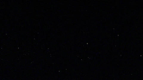 Night Snow Glitters In The Light Beam stock footage