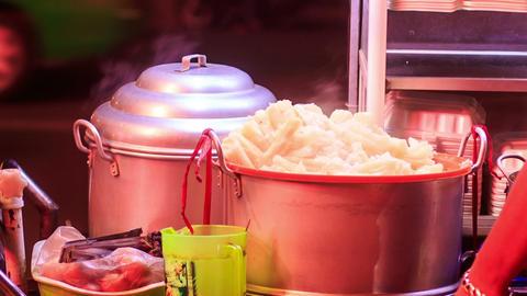 Closeup Vietnamese Street Fast Food Stew-pans at Night Footage