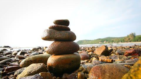 4K Rock stack balance and harmony on sea beach Footage