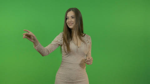 Beautiful young girl doing hand gestures on a green screen background Footage