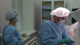 Close-up. Doctor surgeon in protective clothing, performs a gynecological Footage