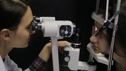 Close-up. The doctor performs a patient's vision study using the newest Footage