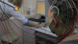 A male patient undergoes medical research using new electronic medical Footage