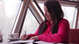 Young business woman working with office documents during office hours Footage
