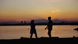 Young couple going to each other at sunset ビデオ